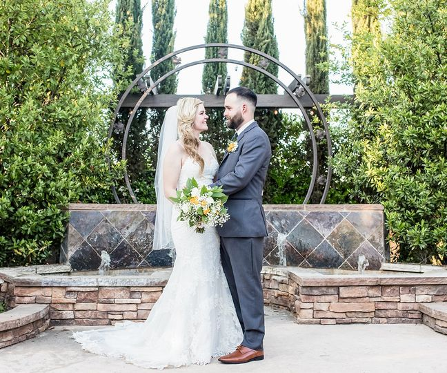 fresno fields by wedgewood weddings bride and groom at the altar 51 441024 160524667488667