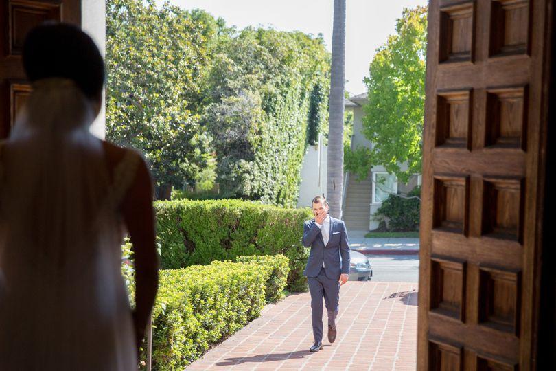 Groom seeing his bride in her wedding dress