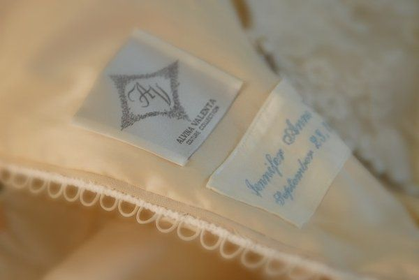 """Add your maiden name as """"something blue"""" in your wedding gown to make it a special heirloom."""