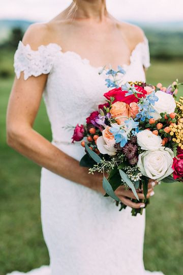 Off-shoulder dress and bouquet | Jared Ladia Photography
