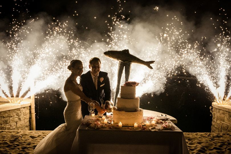 Fireworks while the couple cut the cake