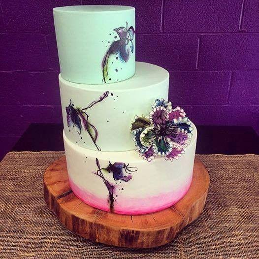 White wedding cake with minimal floral design