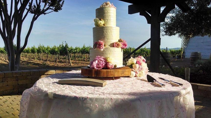 Outdoor wedding cake setup