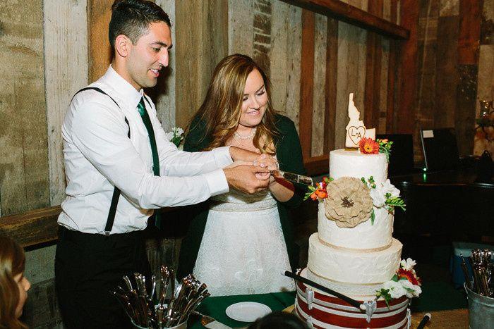Newlyweds slicing the cake