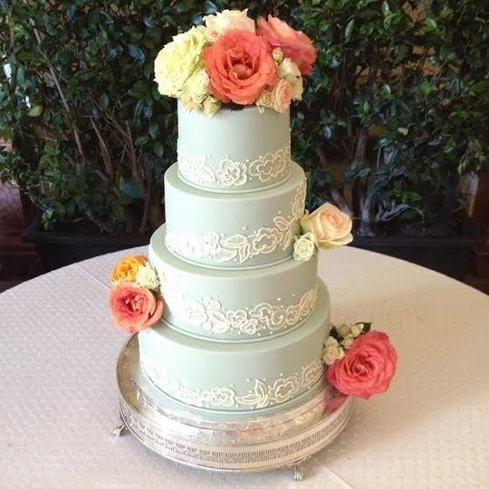 Baby blue wedding cake with flowers