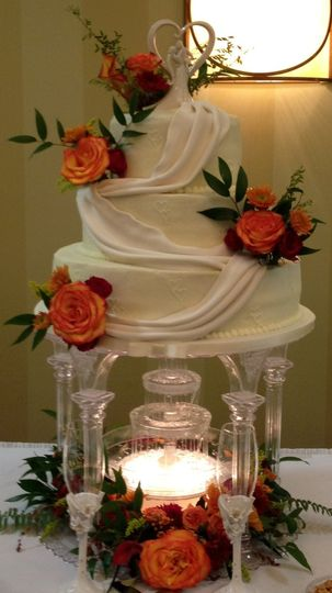 Simple Drape Wedding Cake. This is a buttercream cake with fondant drapes and beautiful fresh fall...