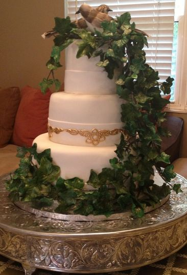 Celtic Wedding Cake. This wedding cake was the combination of a traditionally simple white fondant...