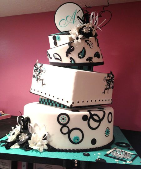 Contemporary Wedding Cake. This fondant covered topsy turvy wedding cake exudes fun and whimsy.  The...
