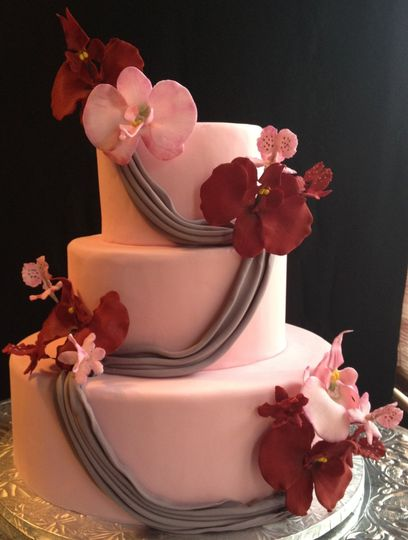 Orhid and Drape Wedding Cake. This contemporary fondant covered cake maintains simplicity while...