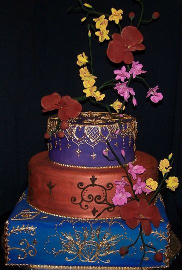 Fantasy Indian-Style Wedding Cake. This fondant covered cake is the epitome of fantasy.  The...