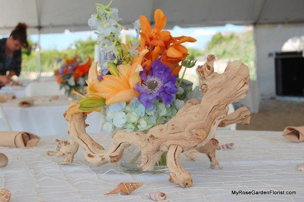 Sunset shade centerpiece with lilies, hydrangea, scabiosa & grapewood accent. Perfect for your beach...