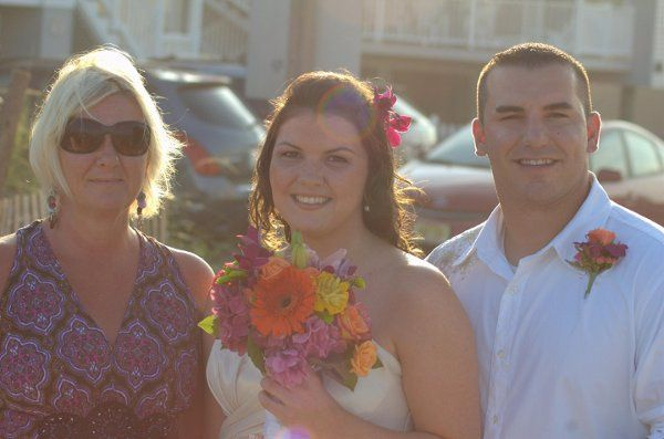 Bride on the way to the wedding! Stunning bouquet of vibrant summer flowers - roses, lilies,...
