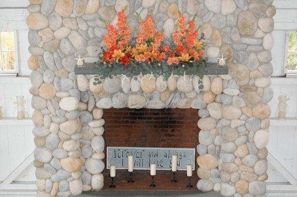 Bonnet Island wedding - sunset toned lilies, gladiolas to decorate the beautiful stone fireplace...