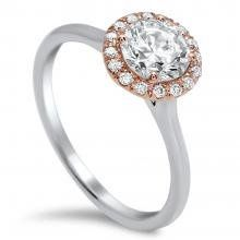 Timeless Designs halo style engagement ring with Rose gold and white gold.