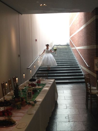 Bride goes down the stairs
