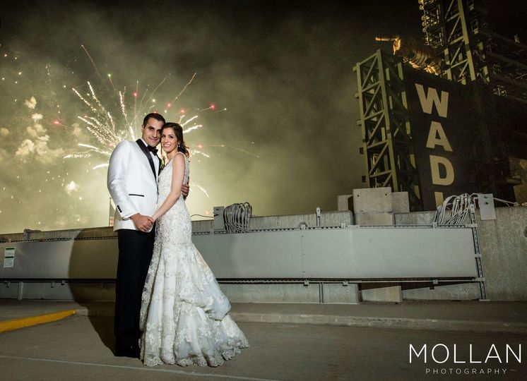 Fireworks behind the beautiful couple