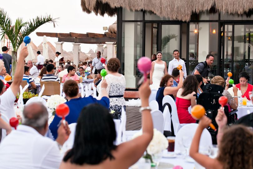 maraca professional photo of guests shaking