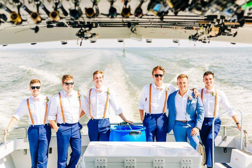 Groomsmen arrive via boat