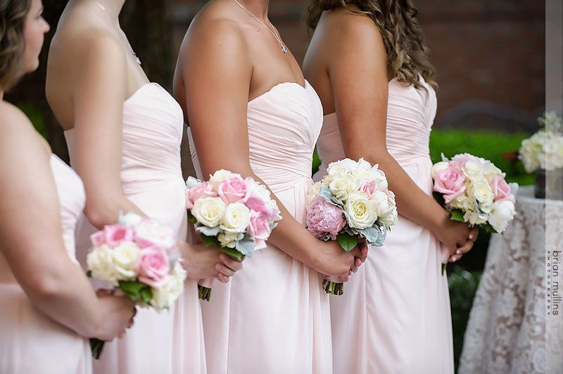 bridesmaids at a gorgeous outdoor ceremony at the