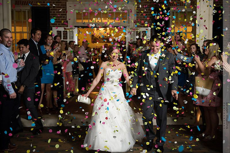 couple being feted with confetti at the prestonwoo