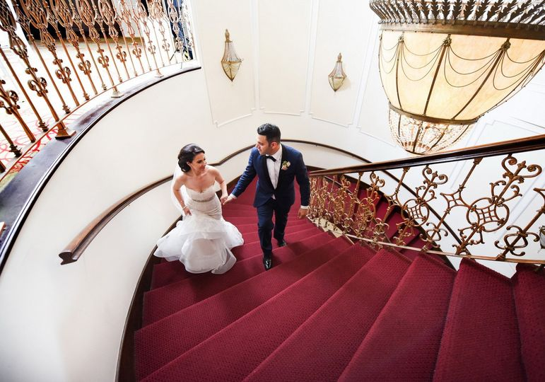 Newlyweds at staircase