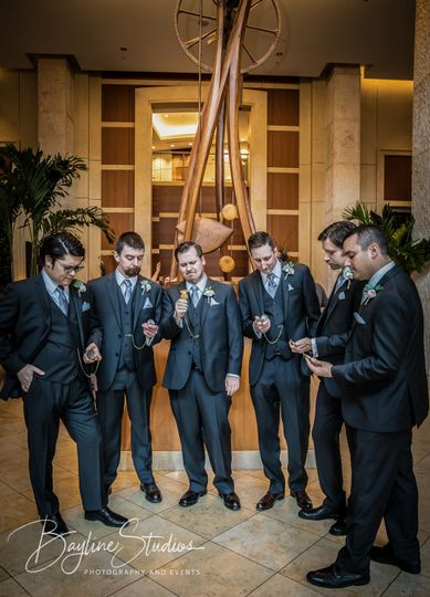 Groom and Groomsman Synchronizing Watches
