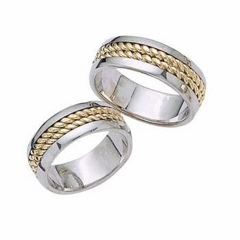 This amazingly crafted 14k two tone gold, his and hers wedding band is designed to have a smooth and...
