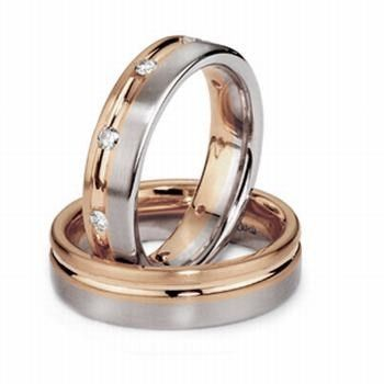 This stunning 14k white and rose gold his and her wedding band looks even better by making adding...