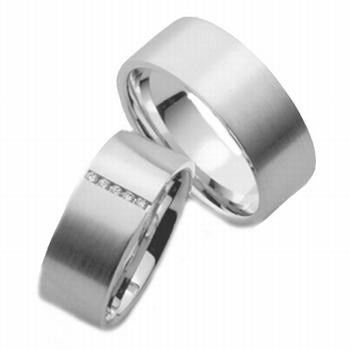 This his and hers 14k white gold wide wedding band has a flat surface with sandstone finish and...