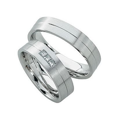 This 14k white gold flat surface wedding band has a matte finish with a shiny parallel cut through...