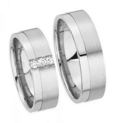 This 14k white gold his and hers flat surface wedding band has a matte and shiny finish with a shiny...