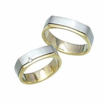 His and Hers handmade wedding bands is crafted in 14k two tone gold in a square shape exterior and...