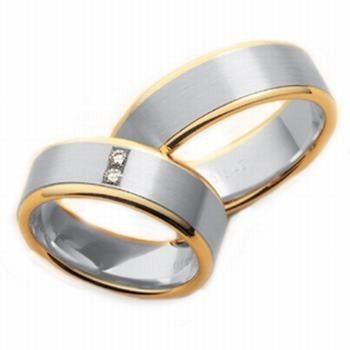 This plain and classic comfort fit his and hers wedding band feature white gold center with shiny...