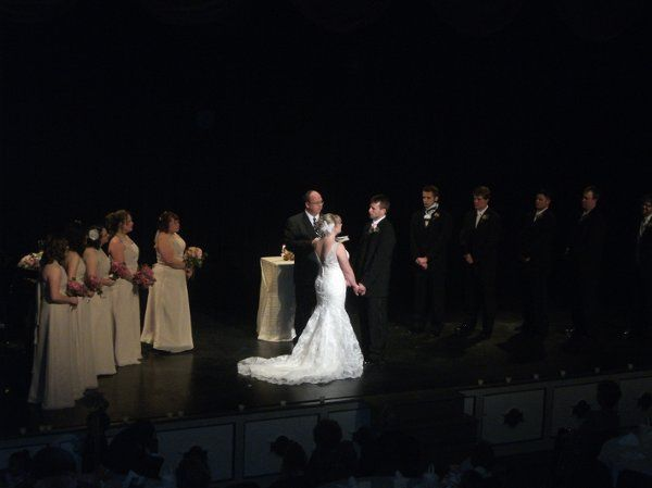 Bride and Groom on stage during wedding ceremony.