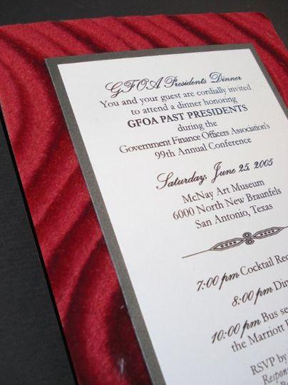 Black and white invite on red velvet board