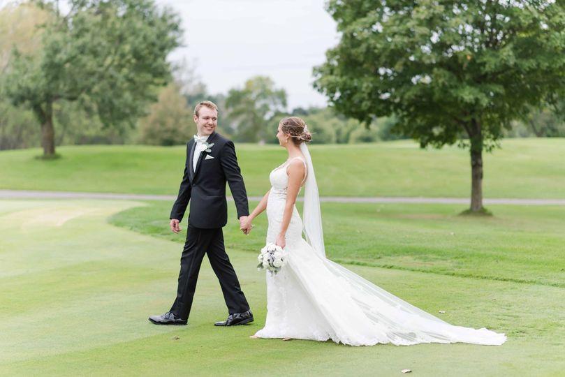 Groom leading his bride