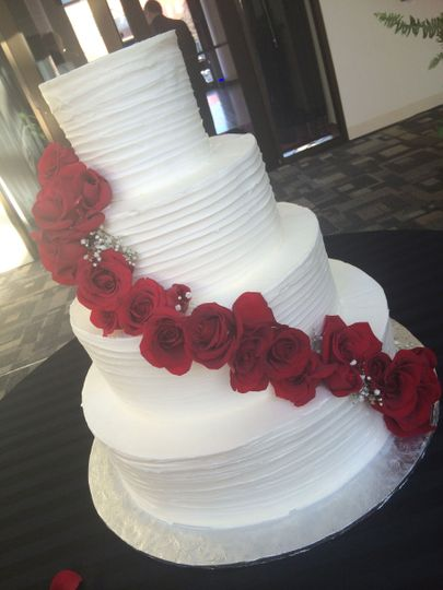 Classic white cake with red roses