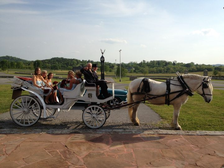 Brides maids, flower girl and grandfather being driven to the steps under the stone arches for an...