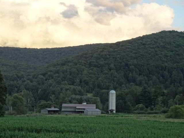 BARN VIEW WITH MOUNTAIN BACKGROUND...