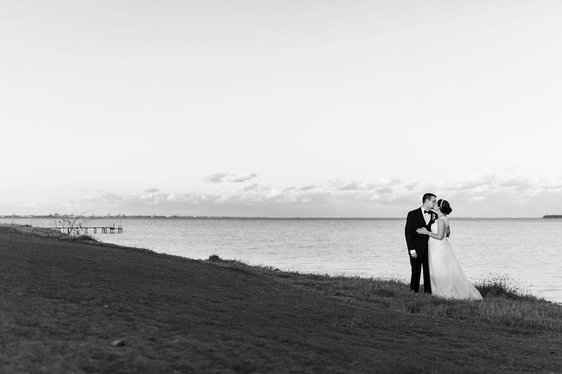 Couple by the shore   Photo by Dragon Photography