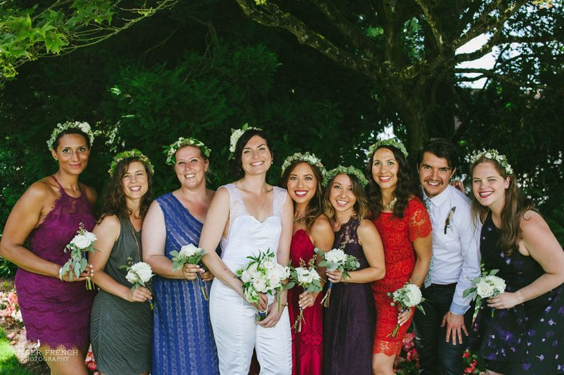 Bride with her crew of bridesmaids, with floral head bands and bouquets. Amber french photography.