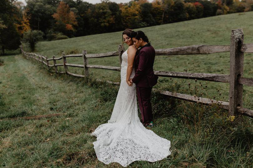 Couple posing in field