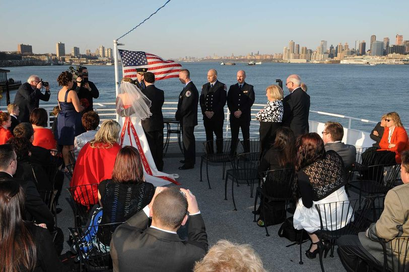 Ceremony on the top deck of the Destiny, docked at 14th St Pier in Hoboken NJ. The NYC Skyline and...