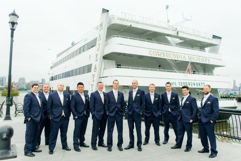 The Groom and his Groomsmen at 14th St Pier in Hoboken NJ, with the Majesty in the background, a...