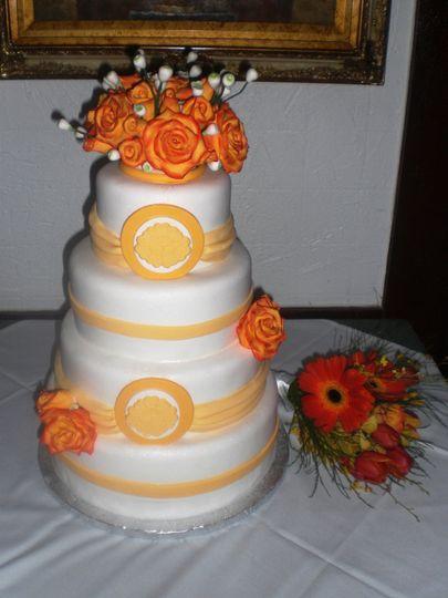 orange and yellow rose wedding cake
