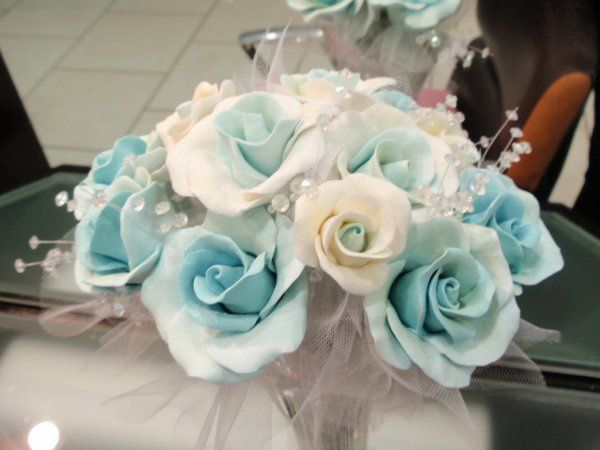 Bridal colors were Ocean Blue and White.  Using her colors, I created several combinations to make a...