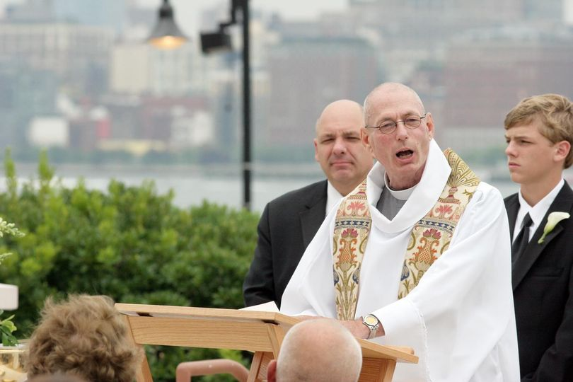 "The Rev. James ""Seamus"" Campbell conducting ceremony"