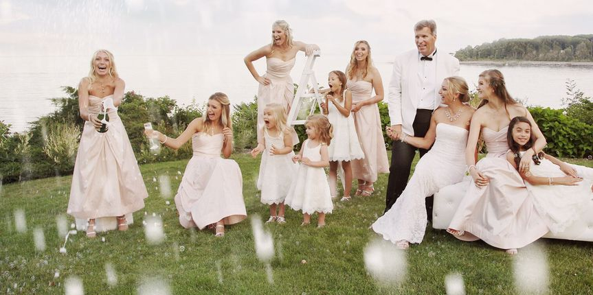 Couple with bridesmaid and flower girls