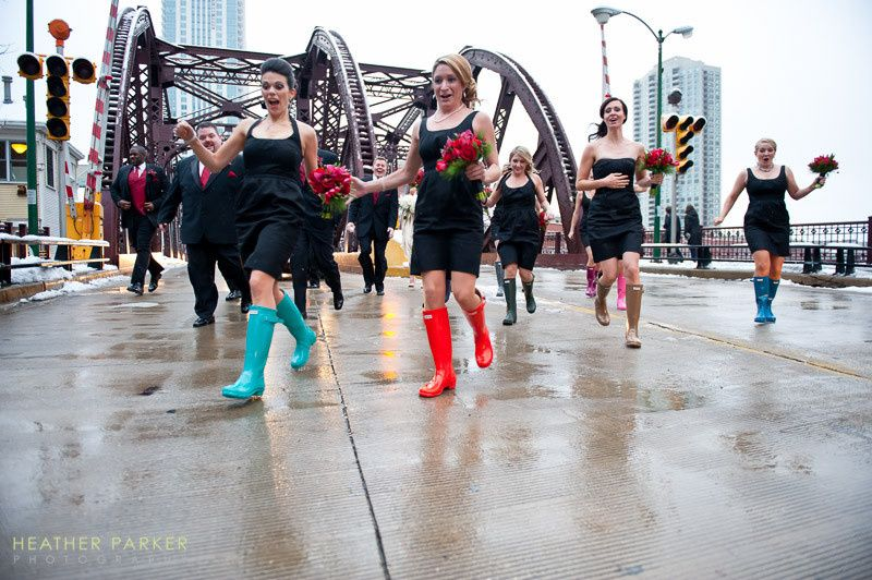 Bridesmaids dodge traffic after a group shot during this InterContinental Hotel  Holy Name wedding...