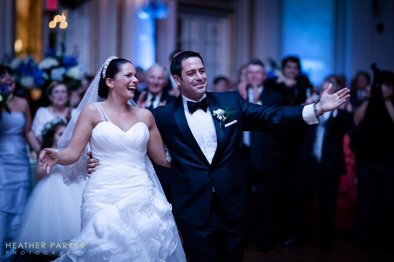 Newlyweds make their grand entrance at this Fairmont Copley Plaza wedding in Boston alongside the...